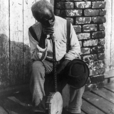 Old Man With Banjo